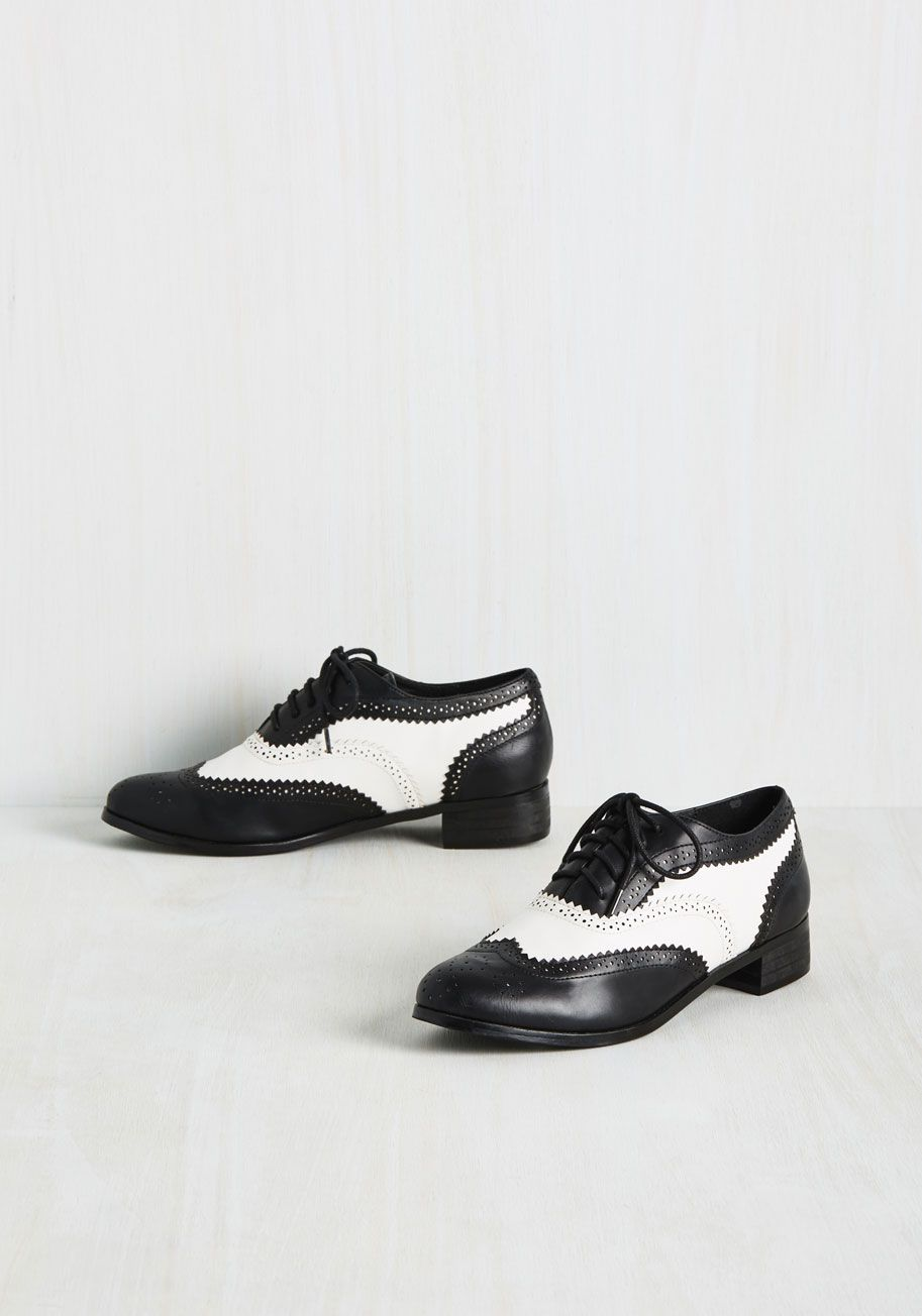 14176e882e9 Your style story starts with these black and white Oxfords
