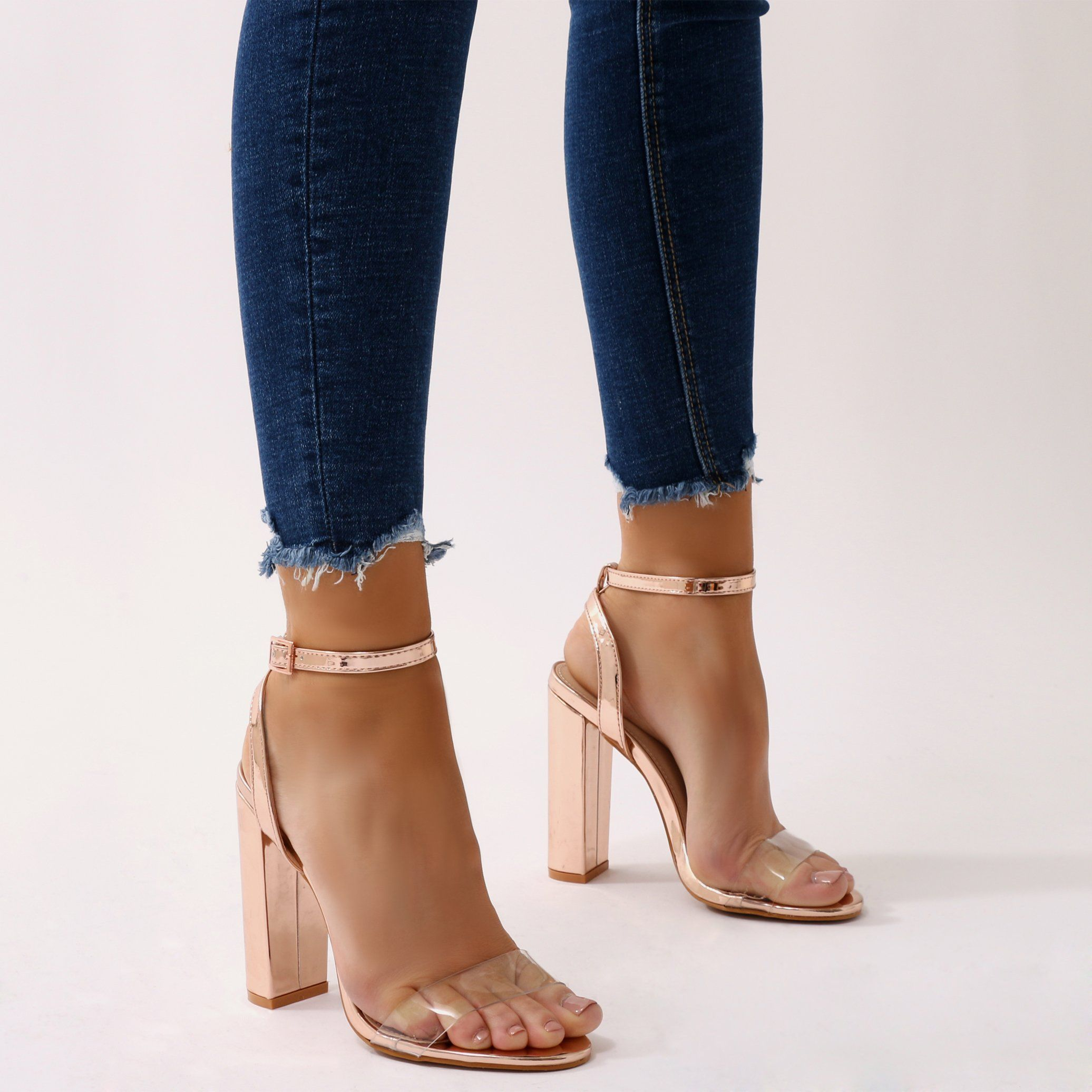 02a4e9429bf Make em stare in these perspex strap block heel barely theres. Featuring  buckled ankle strap. Kill it in a sports luxe look with high waist joggers  and a ...