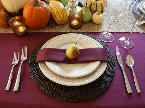 After the holidays, I always stock up on clearance thanksgiving table linens. You can always find rich, jewel tones that work every day to create an elegant table. Just stay away from literal thanksgiving themes!    http://www.hgtv.com/