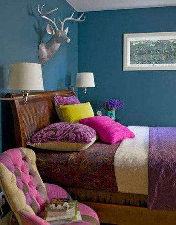 Bohemian Style Master Bedroom With Dark Blue Wall And Antler Over Sleigh Bed Purple Bedding Abd Sconce Side Chair