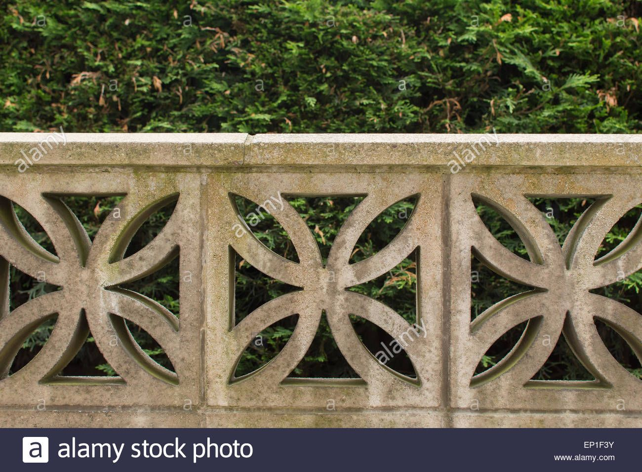 Garden wall built from decorative concrete blocks Stock Photo ...