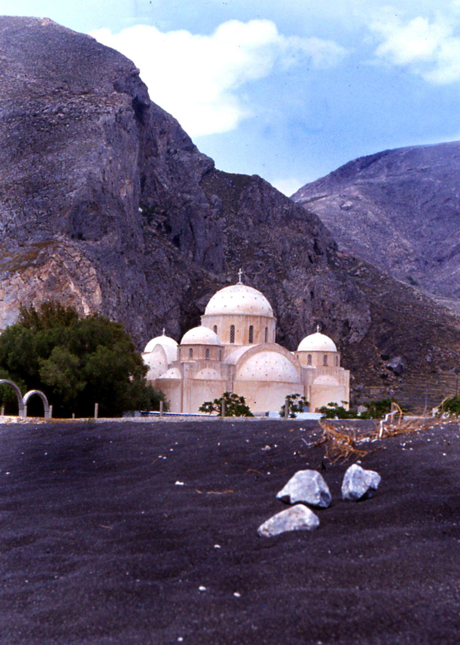 Church On Black Volcanic Beach Santorini, Greece