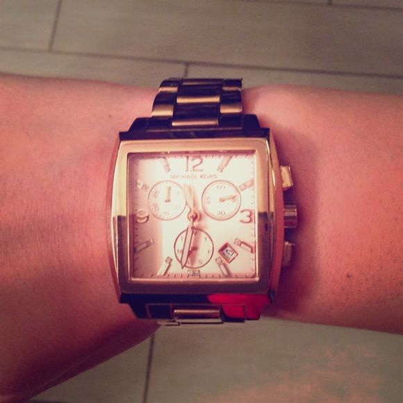 Authentic Michael Kors rose gold watch Rose gold Michael Kors watch with classic square face. Original packaging, extra link included to enlarge the band. MICHAEL Michael Kors Accessories Watches