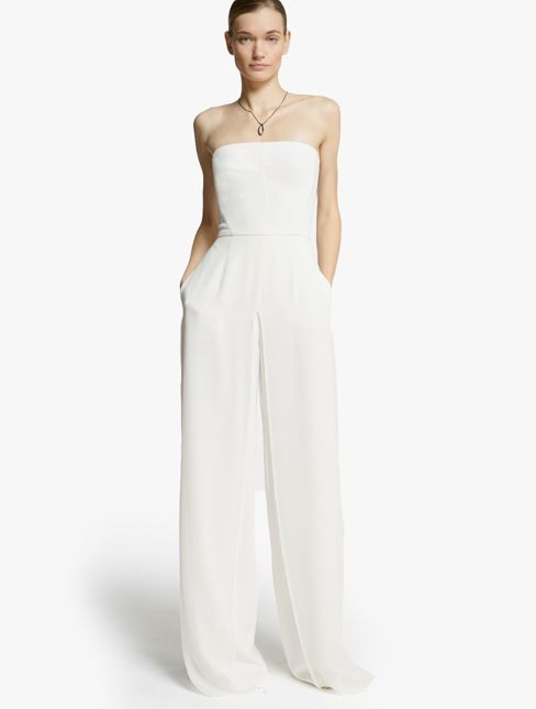 098b8d81c37 Halston Heritage Chiffon Overlay Strapless Jumpsuit. Dramatic movement  takes form in this chic strapless jumpsuit with chiffon overlay and pocket  detail.