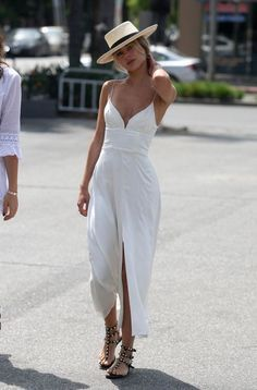 White maxi with a sleek boater hat.