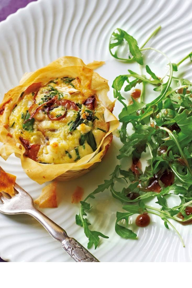 Goat's cheese, broccoli and red onion tartlets with rocket