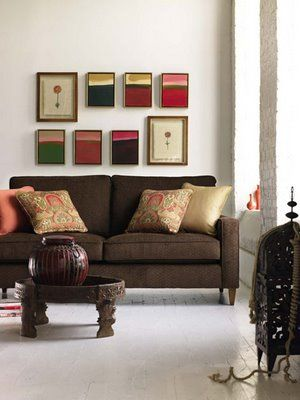 Brown Sofa With Peach And Beige Accent