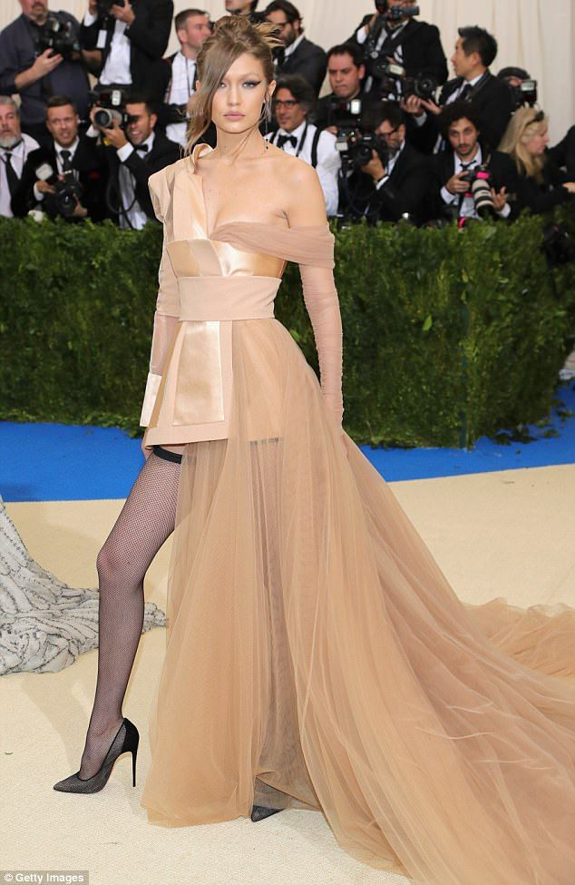 Gigi Hadid Flashes Her Fishnets In Sultry Gold Gown By Tommy Hilfiger Met Gala Dresses Gala Dresses Nice Dresses