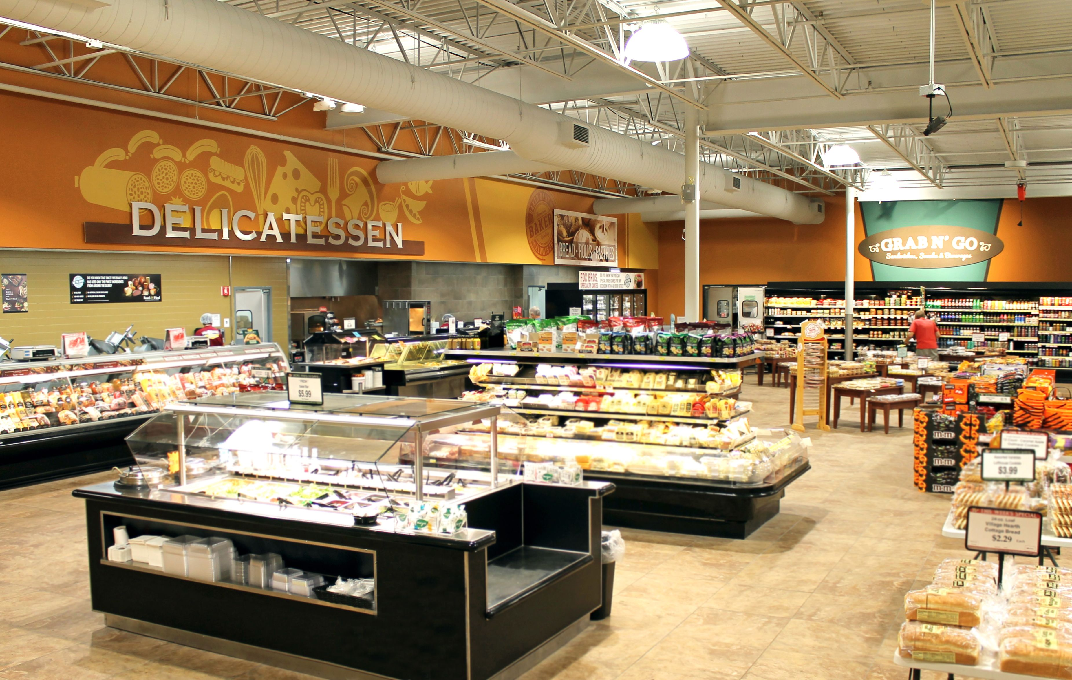 Our grocery store decor design in the deli and bakery area