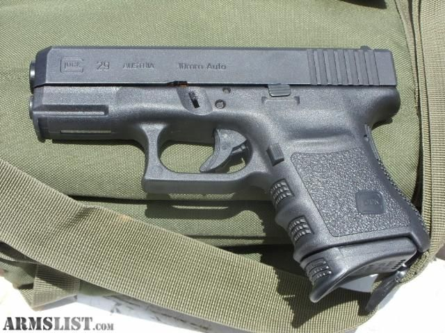 Glock 29, compact 10MM. Drop a charging hog or bear. 100 ...
