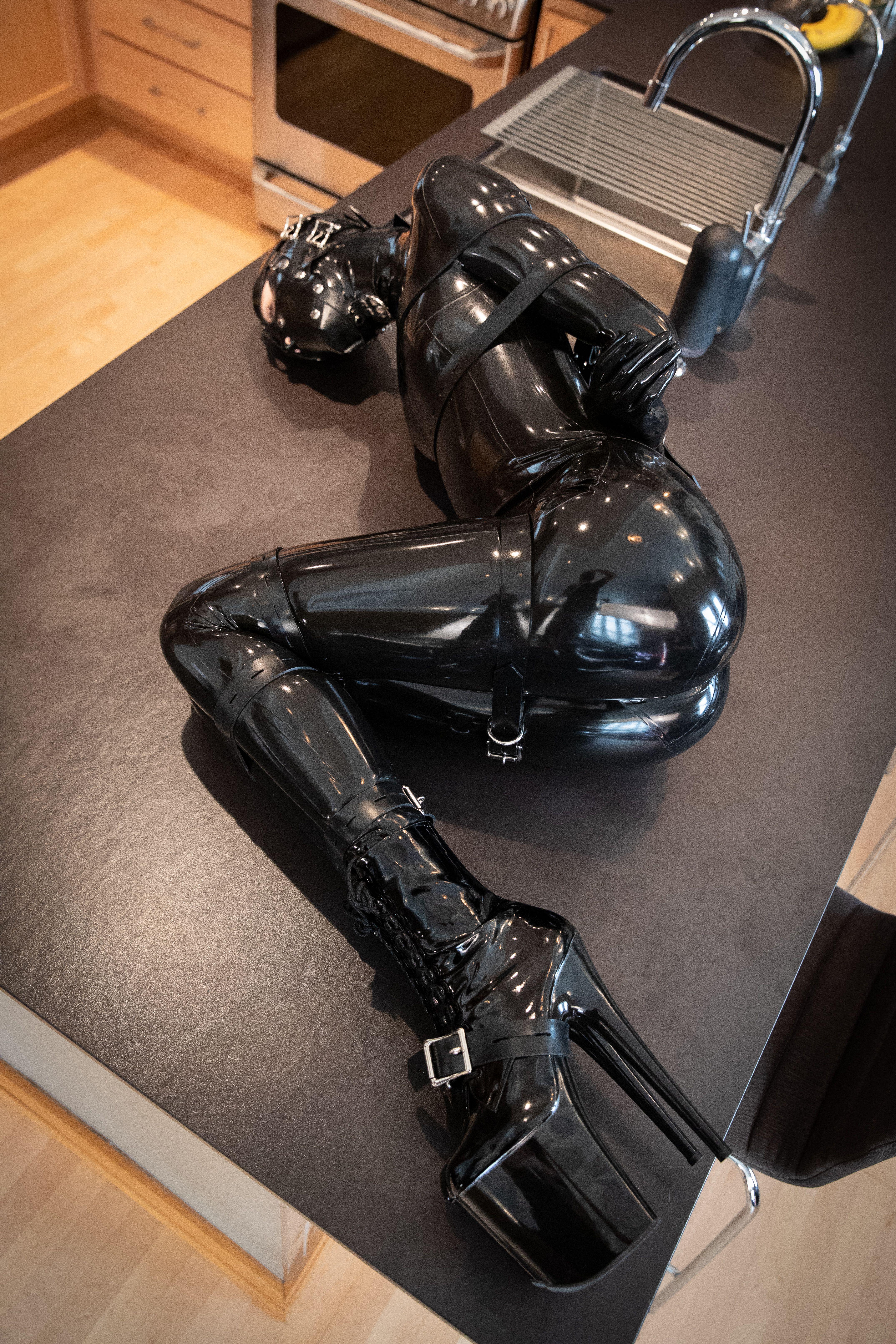 Latex catsuit self bondage