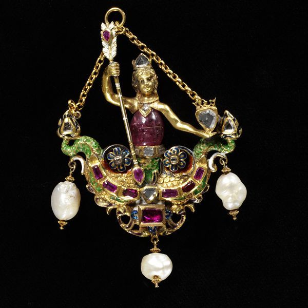 Pendant in the form of a double-tailed mermaid, and in the style of the 16th century. Enamelled gold, set with faceted point-cut diamonds and rubies and hung with pearls; the body is a pink tourmaline bead.