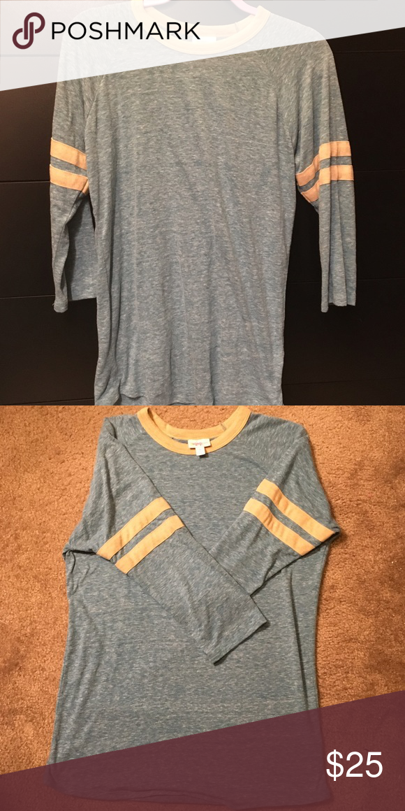 Medium Lularoe Randy baseball tee ⚾️ Worn and washed once per LLR standards. Blue and light mustard color. Very soft. Excellent condition, no signs of wear. 3/4 sleeves. Smoke-free and pet-free home. LuLaRoe Tops Tees - Long Sleeve