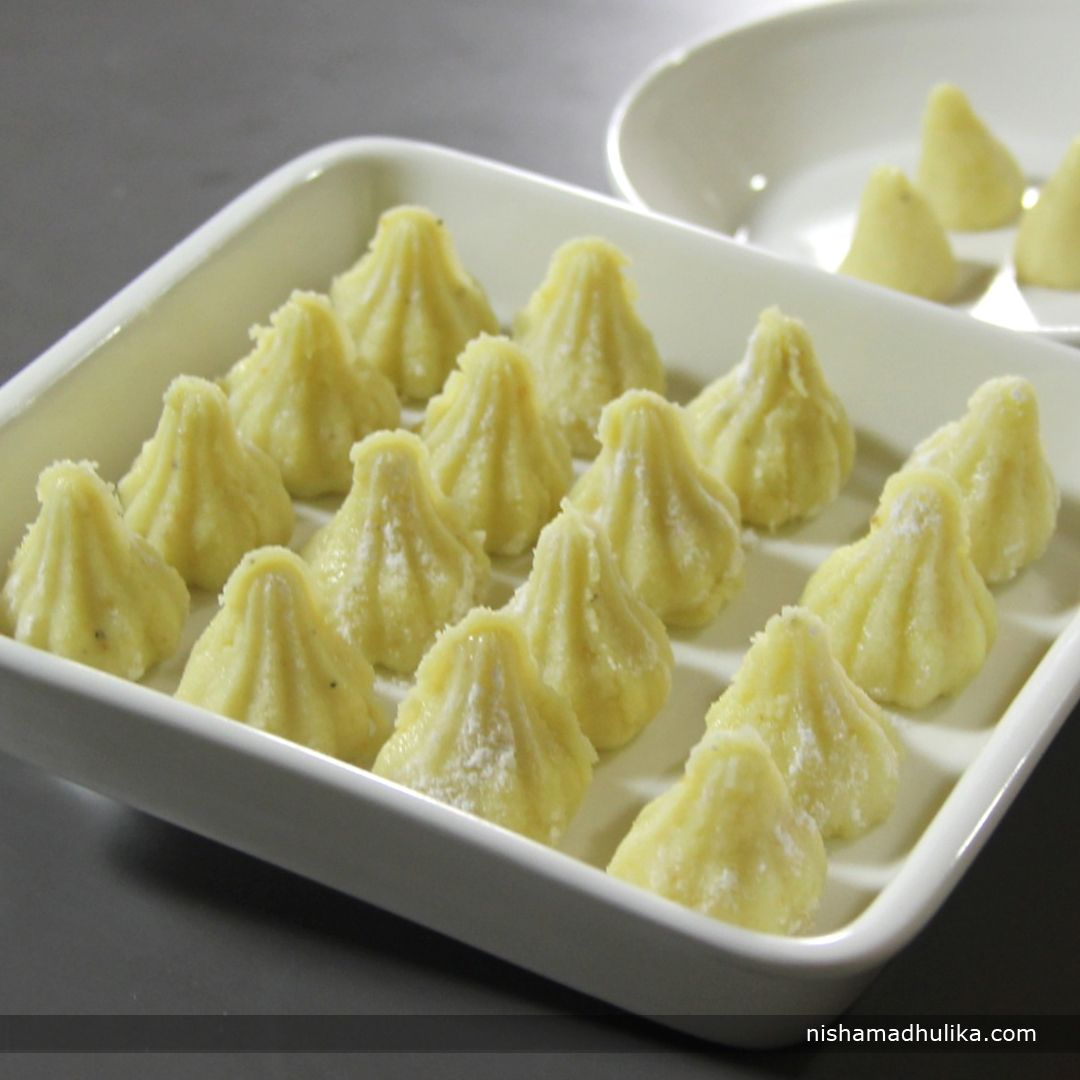 Mawa modak recipe is an easy way to prepare mouth-watering modaks instantly.   Recipe in English - https://goo.gl/31Sgex (copy and paste link into browser)  Recipe in Hindi - https://goo.gl/Pk9sjE (copy and paste link into browser)