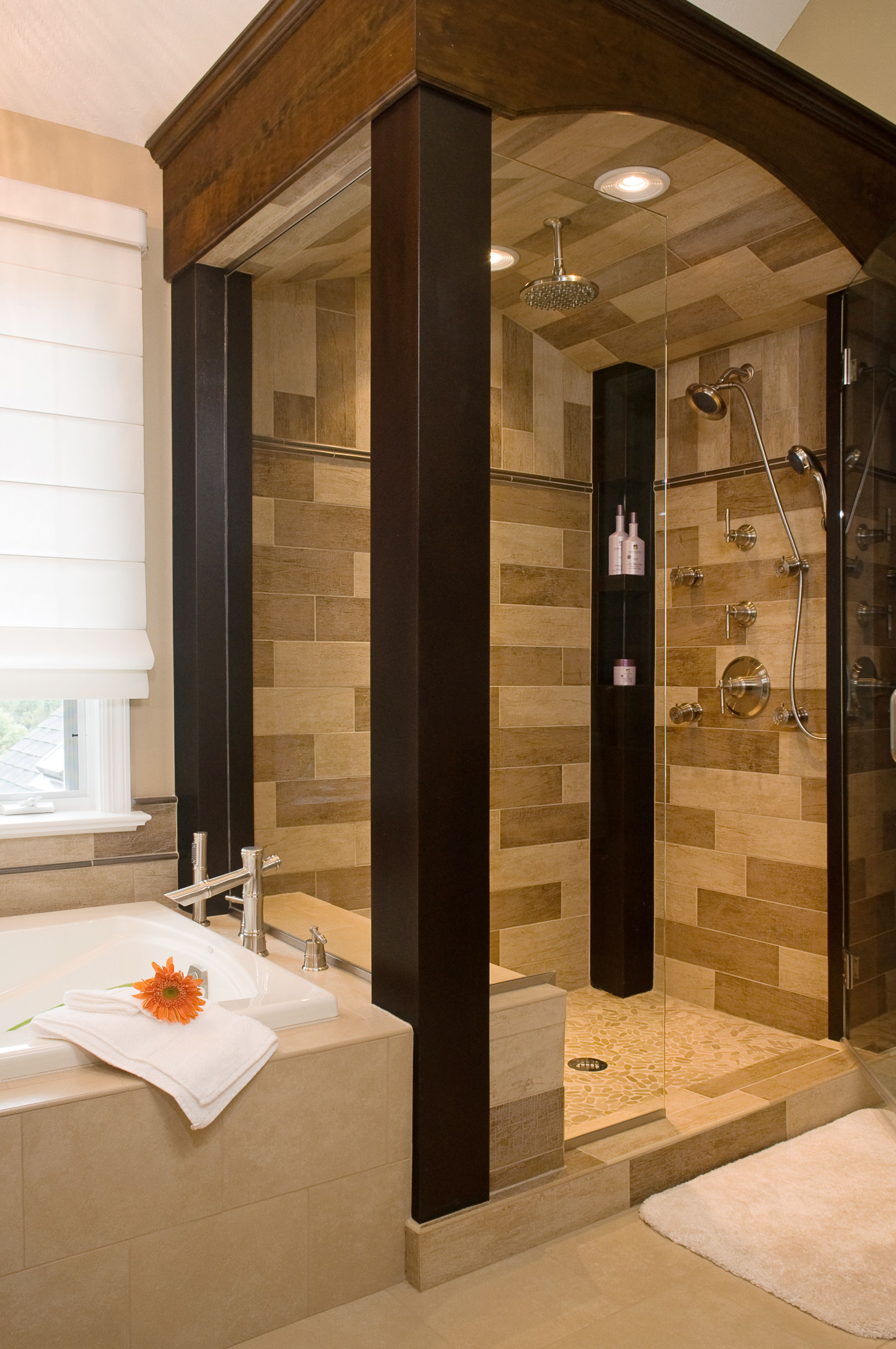 Beautiful custom design on a walk in shower metal columns beautiful custom design on a walk in shower metal columns ceramic tile interior dailygadgetfo Images