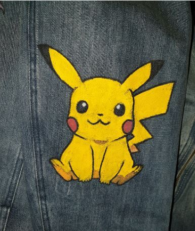 Pikachu on denim jacket This is one of our custom orders A pikachu was drawn on our denim biker jacket This drawing does not come with the original design of the jacket i...