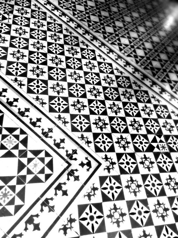 Beautiful tiled floor inside a budhist temple....