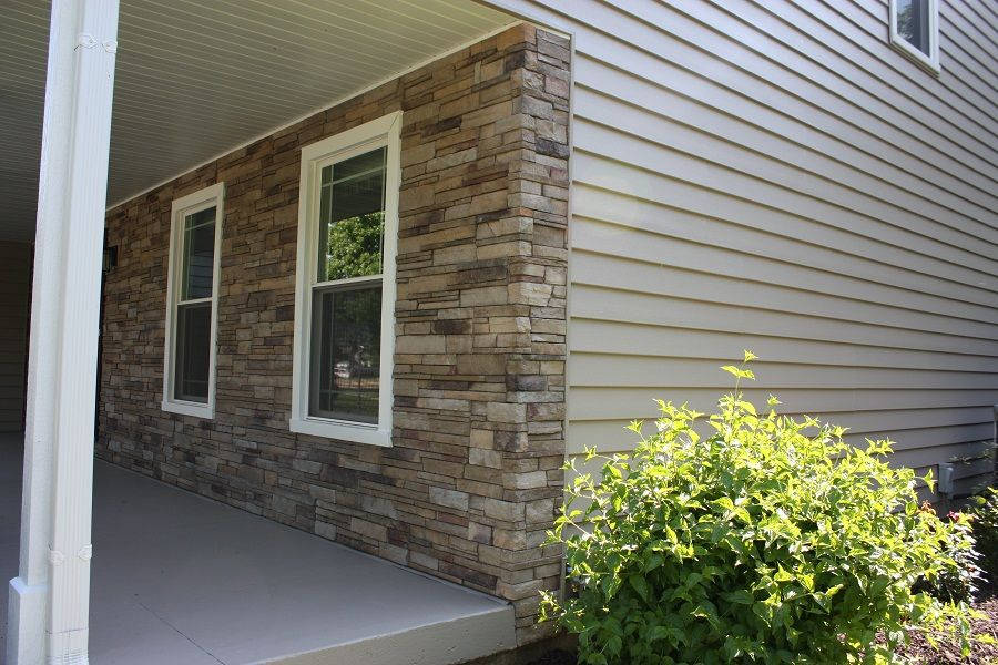 Manufactured Stone By Chicagoland S Siding Experts Hhi Exterior Brick Stone Vinyl Siding House Exterior