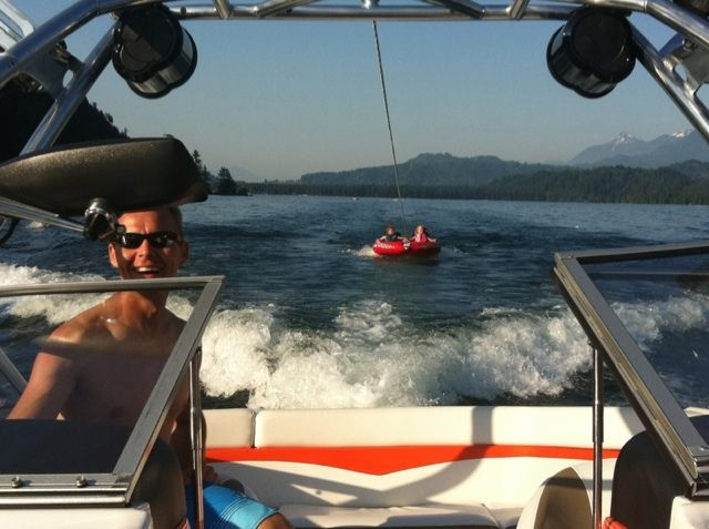 My husband Domonic driving our boat