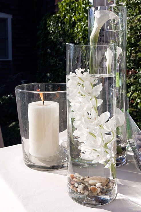 white calla lilies and submerged orchids look modern in. Black Bedroom Furniture Sets. Home Design Ideas