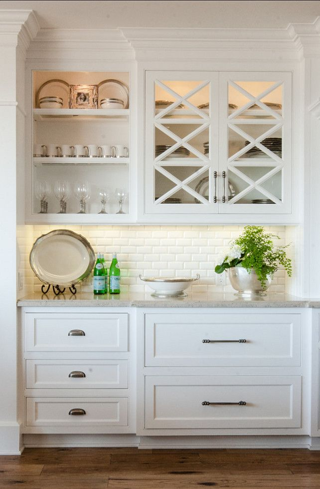 California Beach House with Transitional Interiors - Beautiful cabinet - love the upper cabinet with open space and 'x' glass doors, under-mount lighting.