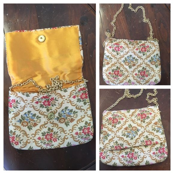 """VTG DELILL Designer Tapestry Purse with Gold Chain This elegant vintage tapestry purse has an overall graceful flower & leaf pattern in soft red, blue, pink, green & gold w/exquisite gold threads throughout on a beige background.   Gold-tone chain can be tucked inside to use as a clutch. Inside lined in gold satin w/one side pocket; tag reads: """"DELILL MADE IN ITALY"""".  Measures 6"""" tall (add 10"""" for chain drop) x 7"""" wide. Bag is in very good, clean condition (the inside hidden brass snap…"""