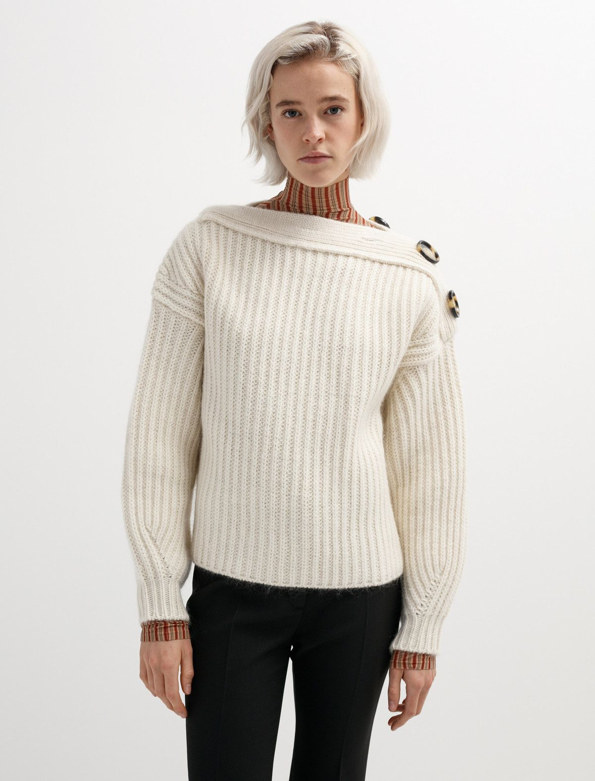 Sweater weather isn't even close to over so lucky for you we've got tons of them on sale. We love this voluminous sweater from Acne Studios. It's knit from soft wool and has four oversized buttons at the neckline that allow you to play with the opening. Also, the curved sleeves accentuate the play in volume which makes for a unique shape. This is a sale item definitely worth cozying up to.
