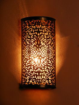 This fine wall lamp with its delicate openwork pattern will spread a soft  subdued light and give a stylish