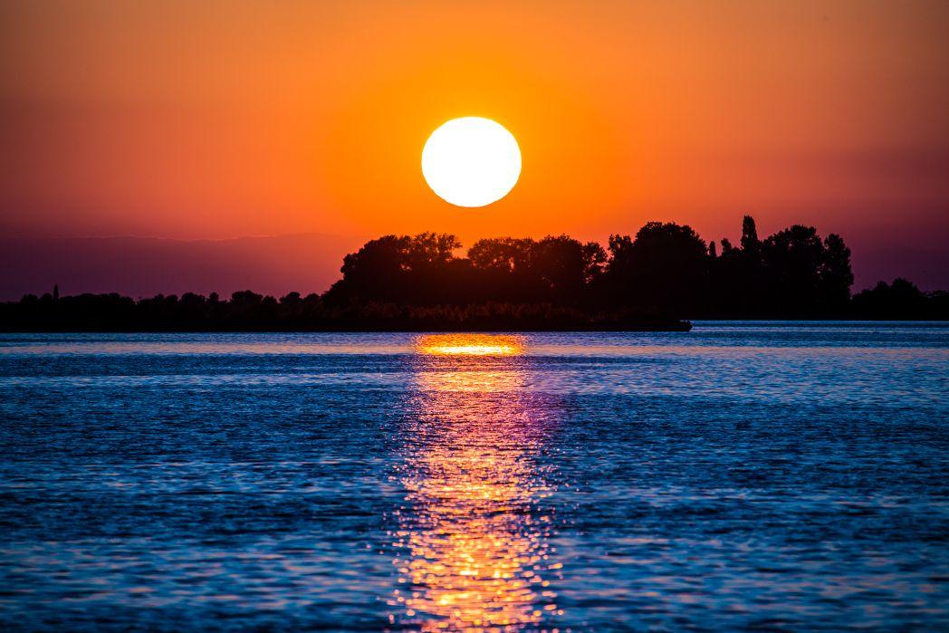 Beautiful sunset photograph taken by Domenico Vallorini, in Grado, Italy!
