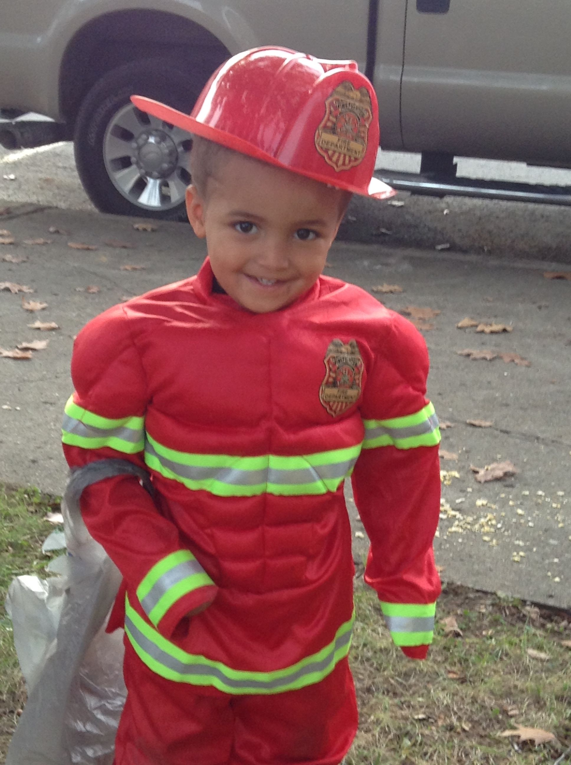 What a cute firefighter in training! He's all smiles for