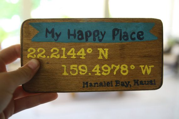 "Cute ""My happy place wooden sign, only $16.00 on Etsy! This handmade wooden sign is 6.75 inches long and 3.5 inches tall. It says ""My Happy place"" on the top, and below it has the latitude and longitude of Hanalei Bay, Kauai, but it can be customised to have your favorite place on it. Below, it says the location of the cordinates. Hand painted and stained, and perfect for home decoration."