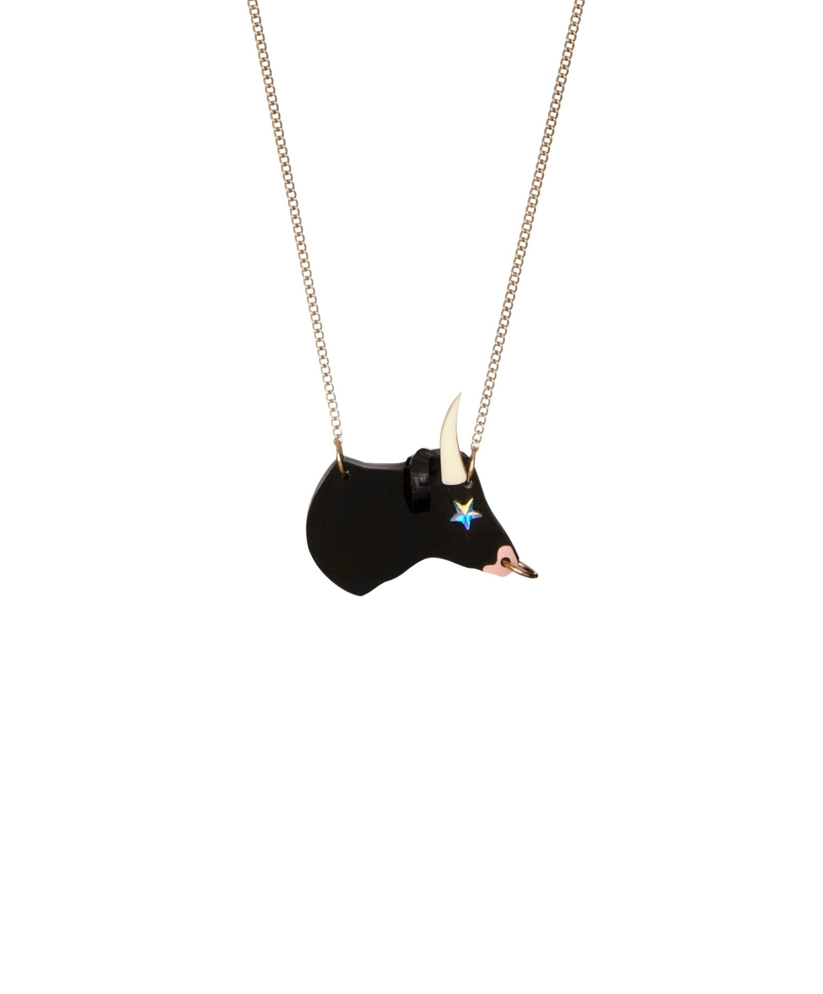Taurus Birthday Necklace - Designed to celebrate the 12 signs of the Zodiac, the Taurus Birthday Necklace is the perfect present. Laser cut in jet black acrylic, a bull appears with hand inked detailing, a nose ring and a sparking star to create our playful twist on this classic symbol.