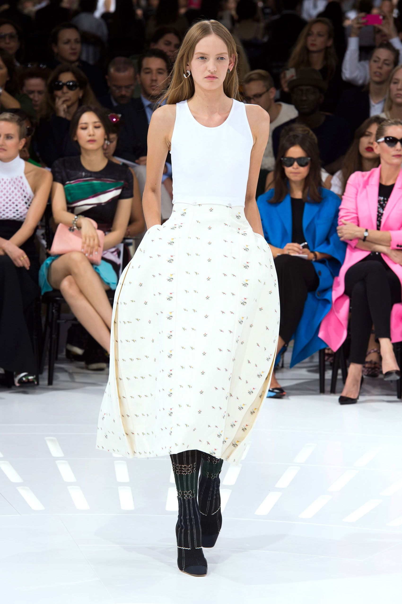 Showing at the Louvre, that bastion of history, Raf Simons offered a Dior collection that talked about both modernity and costume history. So trim white day wear segued into white tanks tucked into skirts with exaggerated volume—as if the girls were modern day Marie Antoinettes.  Imaxtree  - HarpersBAZAAR.com