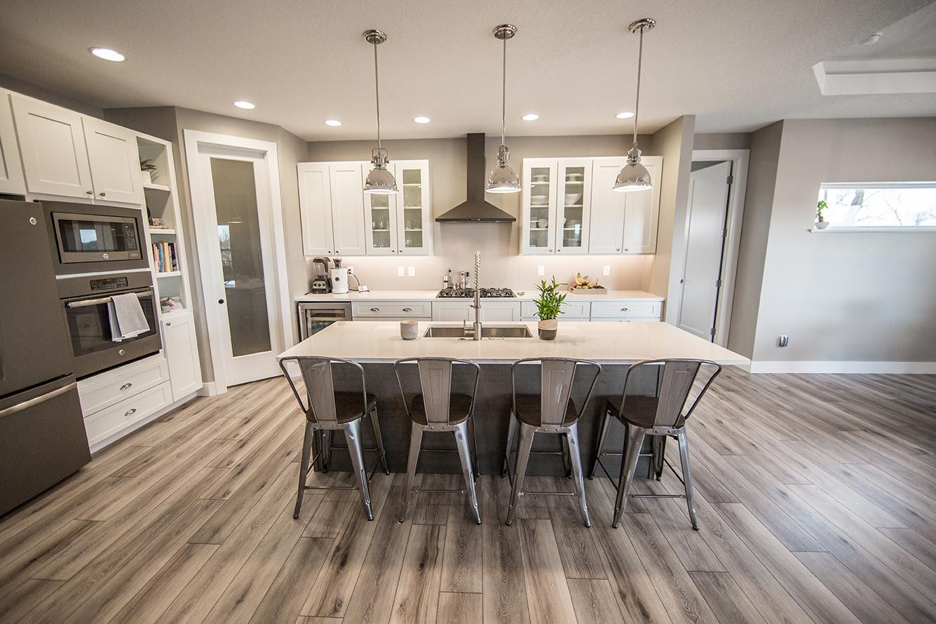 Gorgeous Kitchen With Painted Tundra Cabinets, Hanstone   Tranquility  Counters, Mannington Restoration   Fairhaven   Brushed Taupe Flooring, And  GE Slate ...