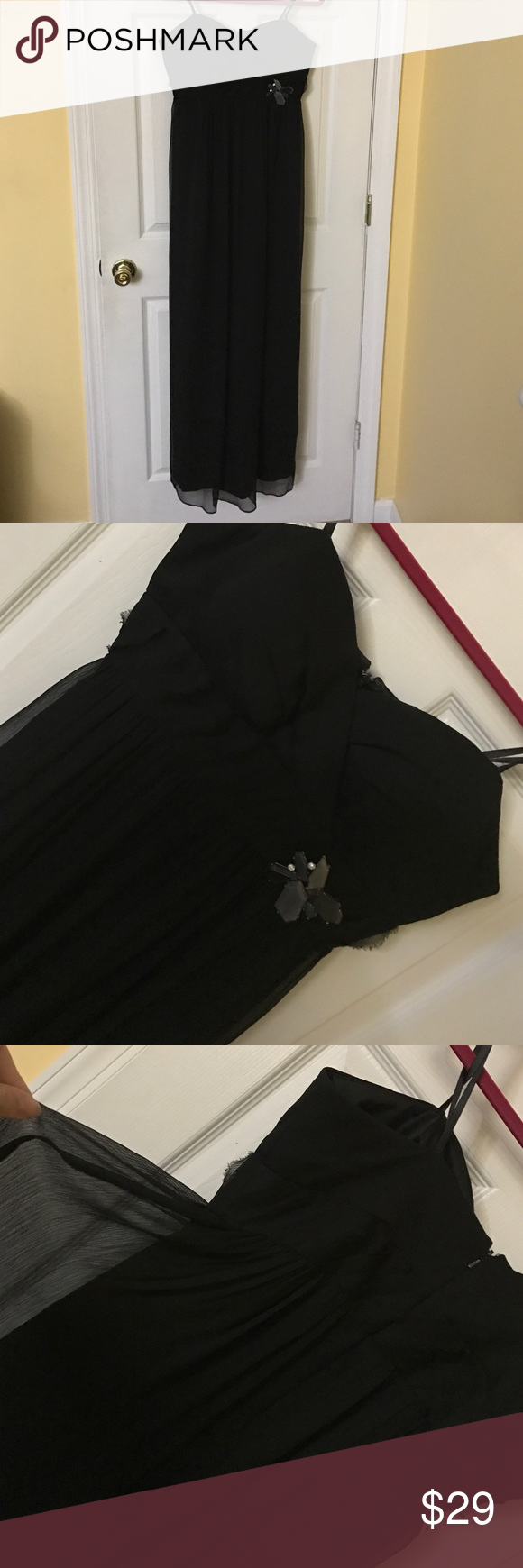 Black strapless dress chiffon with brooch Black strapless dress chiffon with brooch. For tight on chest and lose all the way down to ankles. BCBGeneration Dresses Strapless