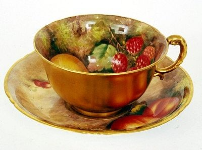 A Royal Worcester cabinet cup and saucer hand-painted with fruit and ...