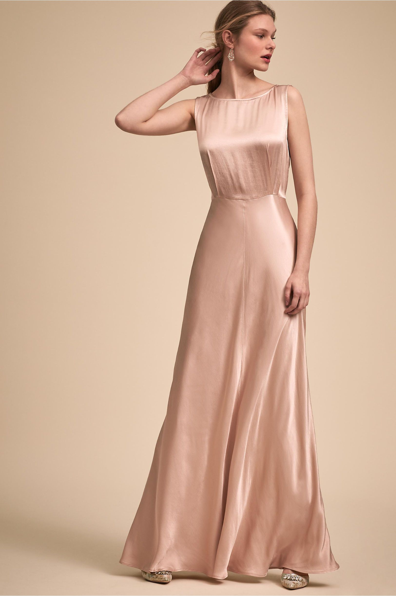7e9dbd938c14 Sleek and luxurious, this column gown features an ultra-flattering bias cut  and a long row of decorative covered buttons.