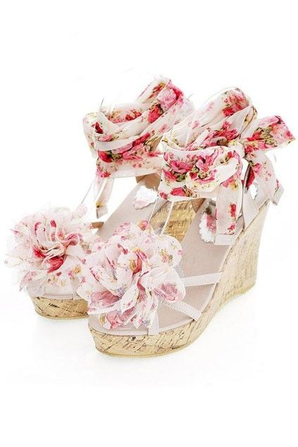 The wedges crafted in PU and leather, featuring very sweet floral main, straps fastening to sides with flower detail, long exquisite floral lace-up ribbon ankle straps, wedge heel and skidproof leather sole.