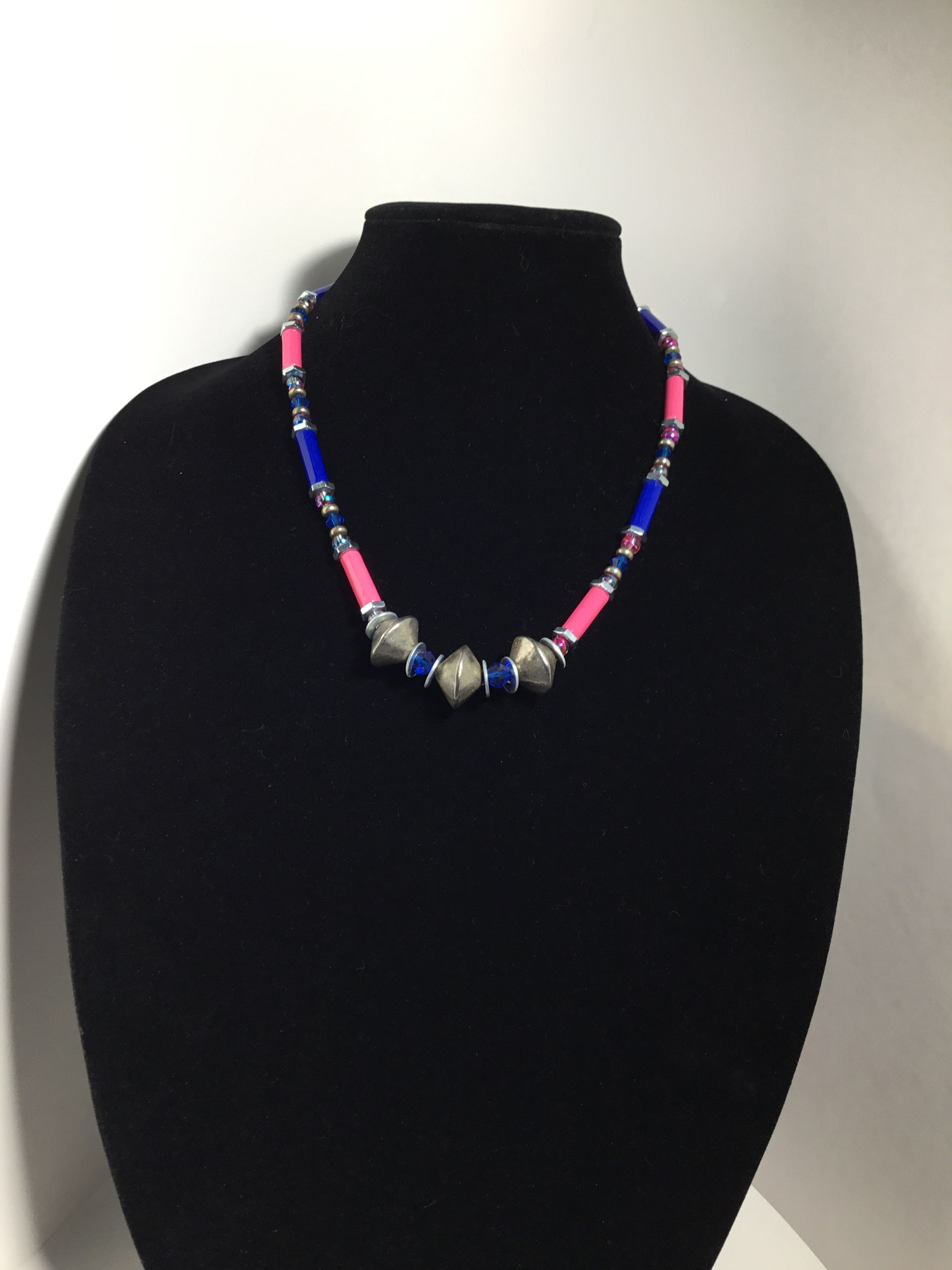 Handmade paper bead necklace accented with brass hex nuts and metal, glass, and Czech glass beads.