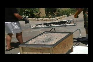 Roasting an entire pig in under four hours can be accomplished with your own homemade La Caja China if you have the necessary woodworking and metal fabrication knowledge. The La Caja China looks like a rectangular wooden wheelbarrow with a grate on top. The pig is sandwiched between metal racks and placed into the wood box lined with metal. An ash...