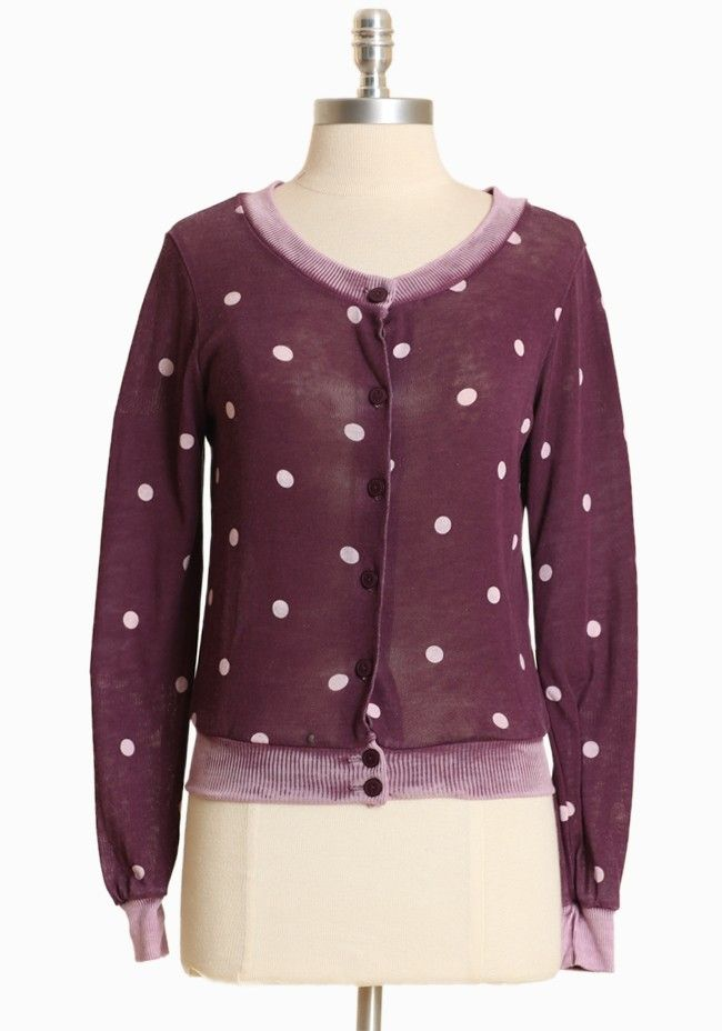 """Little Nell Polka Dot Cardi By Alternative Apparel 79.99 at shopruche.com. Rendered in a delicate and soft cotton blend, this lightweight plum sweater is patterned with a lavender polka dot print. Finished with worn-in detail on the edges and button closures for interest and texture.  50% Cotton, 50% Polyester Made in USA 21.5"""" length from top of shoulder"""