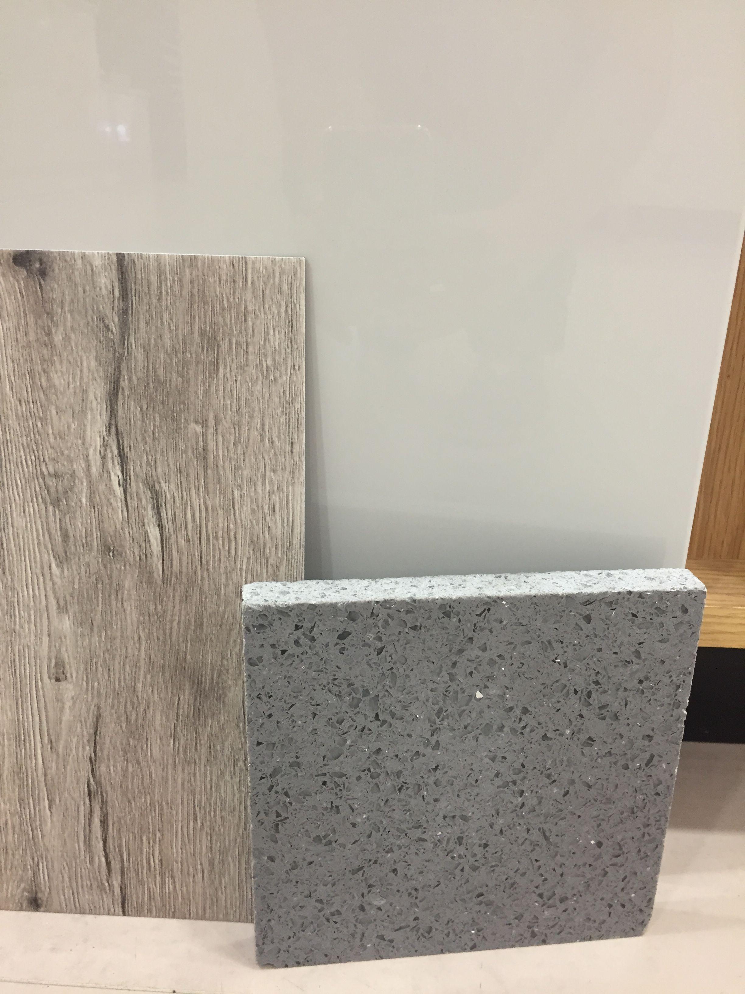 Benchmarx grey gloss, Moduleo Mountain Oak and Stellar Celeste Silestone.