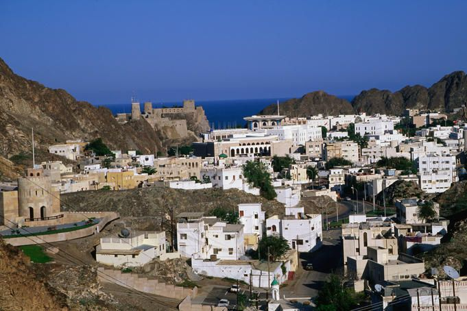 City With Ocean In Distance Muscat Oman When Entering Oman From The Airport You Ll Passed Rocky Mountains Like Sands Desert And Beaut Places City Old Fort