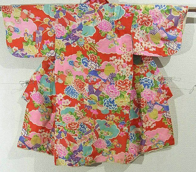 This is a girl's vintage kimono with seasonal flowers such as 'Botan'(peony) and 'Kiku'(chrysanthemum) and ball on cloud pattern, which is dyed