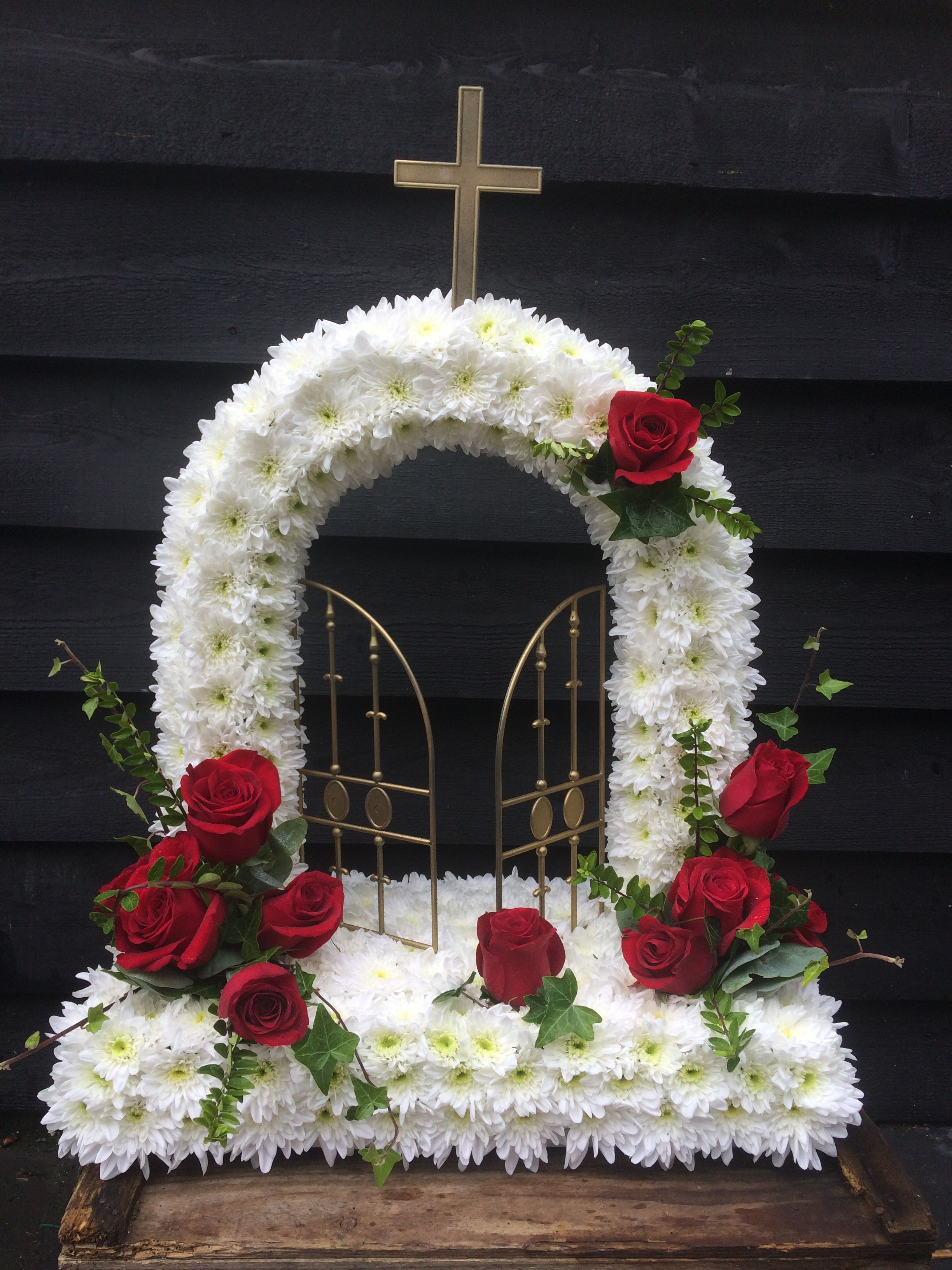 Gates of heaven massed in white with red rose sprays funeral gates of heaven massed in white with red rose sprays izmirmasajfo