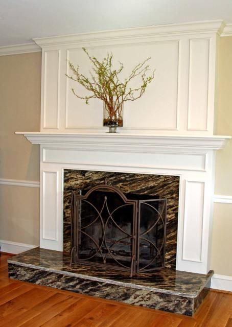 Fireplace surround with raised hearth black marble ...