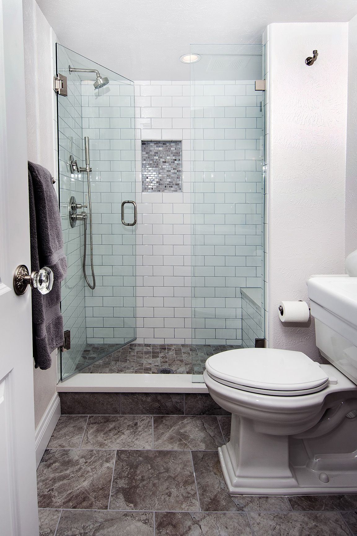 White subway tile shower walls with tiled mosaic niche, handheld ...