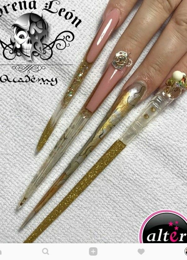 Extreme stiletto nails by lorena leon   Extremely long nails ...