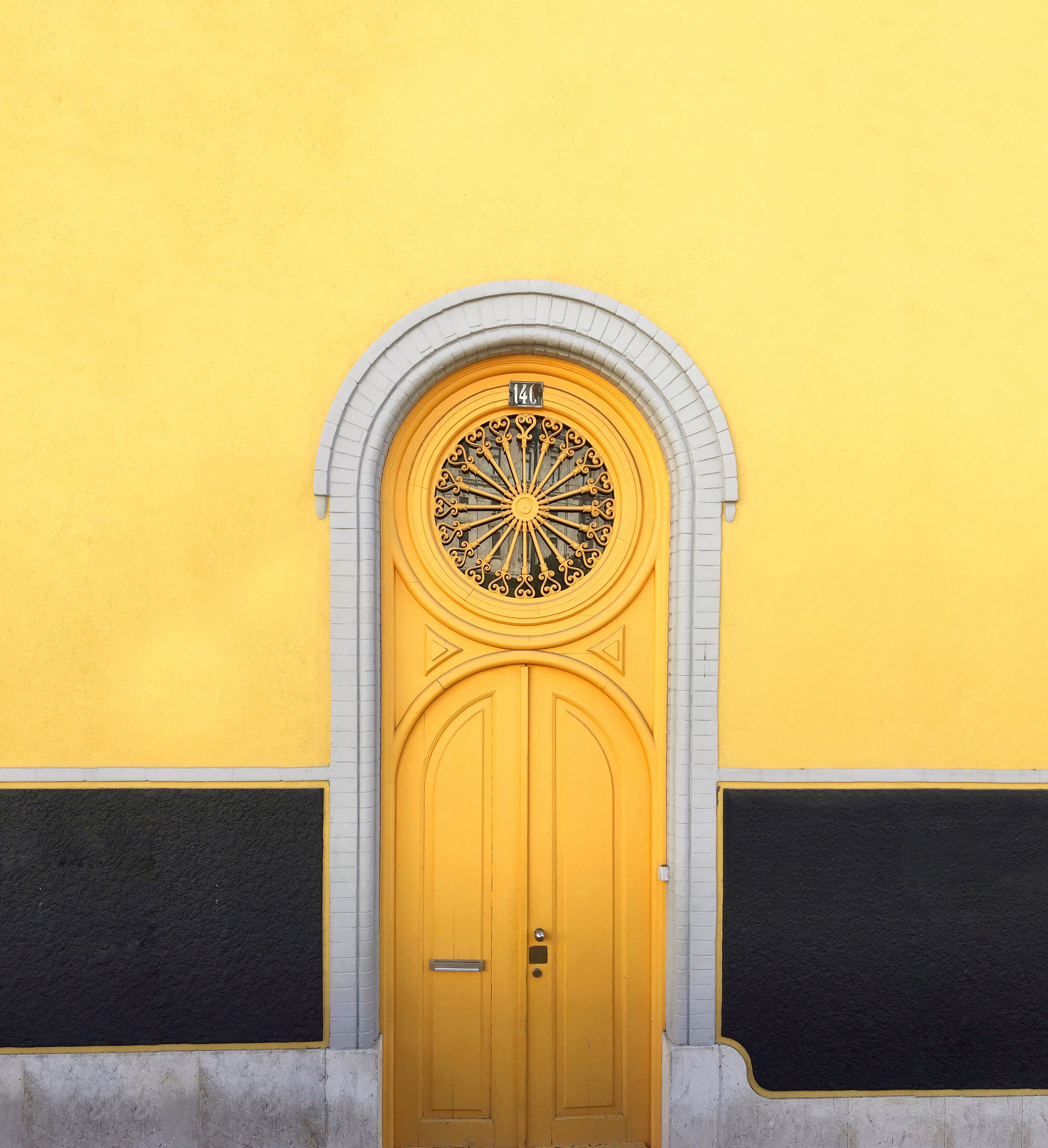 Yellow Door photo by Karla Caloca karlacaloca on Unsplash