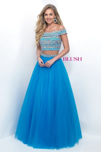 Blush Style 11249. Captivating cap sleeve two piece that features a fully beaded bodice in a unique pattern of color coordinating stones and crystal chains complete with a high waisted tulle skirt. Ocean, Size 10, $269 available at Debra's Bridal Shop, 9365 Philips Hwy.,    904-519-9900.